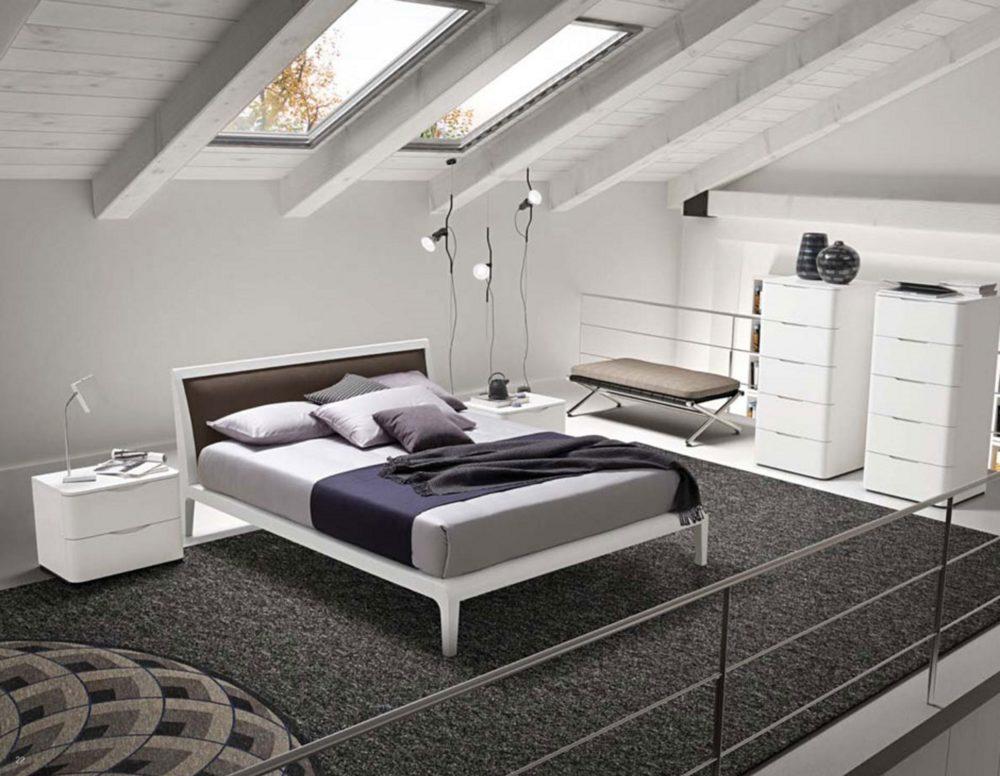 camera da letto in mansarda attico